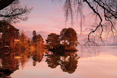 Sunrise on Derwentwater. With the morning mist stock images