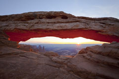 Sunrise In Desert Through Mesa Arch, Utah, USA Stock Image