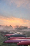 Sunrise at Dijle. With kayaks in front Royalty Free Stock Photography