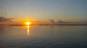 Sunrise. Dirty glass of the vessel served as filter for a picture perfect sunrise Royalty Free Stock Photos