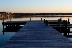 Sunrise at the dock on the river. Quite, peaceful sunrise by the dock on the river Royalty Free Stock Image
