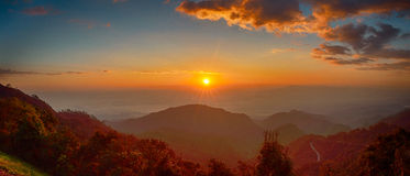 Sunrise at Doi Ang Kang. Panoramic shot of the rising sun at Doi Ang Kang,Chiang Mai, Thailand Royalty Free Stock Photos