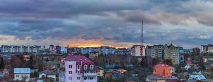 Sunrise dramatic clouds city. Sunrise and dramatic clouds over the city of Ivano-Frankivsk, Ukraine Royalty Free Stock Photo