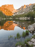 Sunrise on Dream Lake. The first warm light of sunrise on Hallett Peak is reflected in Dream Lake in Rocky Mountain National Park, Colorado Royalty Free Stock Photo