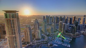 Sunrise in Dubai Marina with towers and harbor stock footage