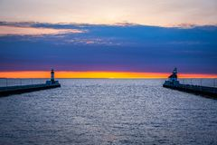 Sunrise at the Duluth harbor entrance. Sunrise at the Duluth Harbor entrance on Lake Superior. Calm waters Royalty Free Stock Photography