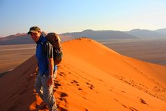 Sunrise at dune 45. Tourist hiking dune 45, Namibia Stock Images
