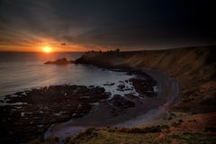 Sunrise at Dunnottar castle Stock Images