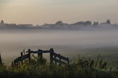 Sunrise on the Dutch canal barrier. Early misty morning at the canal and bridge nearby Hazerswoude and Leiden, Netherlands stock photography