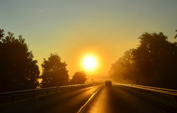 Sunrise in early morning mist Stock Photography