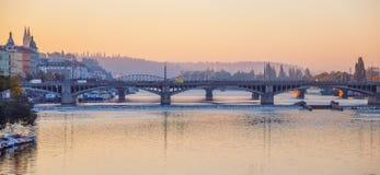 Sunrise early morning over bridge on Vltava river in Prague Stock Images