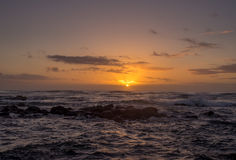Sunrise on eastern shore of Kauai. In Lydgate State park Stock Photography