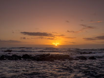 Sunrise on eastern shore of Kauai. In Lydgate State park Royalty Free Stock Photography