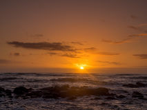 Sunrise on eastern shore of Kauai. In Lydgate State park Stock Image