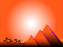 Sunrise in Egypt. With pyramids and palms Stock Photo