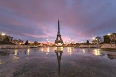 Sunrise on the Eiffel tower reflection stock photography