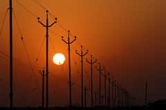 Sunrise on the highway and wires. Sunrise on electric wires along a highway of Rajasthan state Stock Image