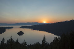 Sunrise at Emerald Bay, Lake Tahoe, California. Sunrise over Emerald Bay in Lake Tahoe, California over pine forest banks stock photo