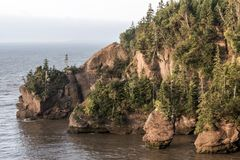 Sunrise famous Hopewell Rocks geologigal formations at low tide biggest tidal wave Fundy Bay New Brunswick Canada Stock Image