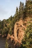 Sunrise famous Hopewell Rocks geologigal formations at low tide biggest tidal wave Fundy Bay New Brunswick Canada Stock Photos