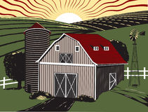 Sunrise Farm. A gray barn with farmland and sunrise in the background Royalty Free Stock Photography