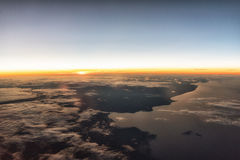 Sunrise at 35,000. Feet enroute to Europe on a passenger airliner Royalty Free Stock Photos