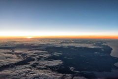 Sunrise at 35,000. Feet enroute to Europe on a passenger airliner Stock Image