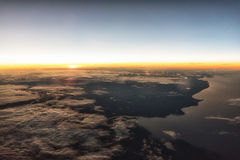 Sunrise at 35,000. Feet enroute to Europe on a passenger airliner Stock Images