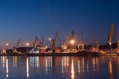 Sunrise in Feodosia sea port. Work goes all days and nights stock photos