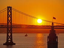 Sunrise between Ferry Building & Bay Bridge Royalty Free Stock Photos