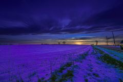 Sunrise at a field covered with snow. royalty free stock image