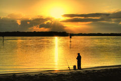 Sunrise Fisherman Stock Photo