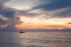 Sunrise and fisherman. Stock Photography