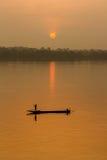 Sunrise and fisherman. Royalty Free Stock Images