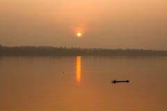 Sunrise and fisherman. Stock Images