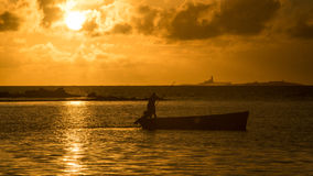 Sunrise Fisherman Stock Images