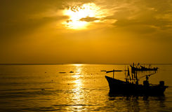 Sunrise with fishermen boats silhouettes Royalty Free Stock Image