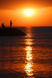 Sunrise fishing Royalty Free Stock Image
