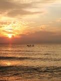 Sunrise fishing boat stock image