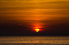 Sunrise and a fishing boat at Aegean sea Stock Photo