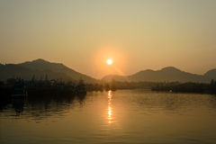 Sunrise and fishing boat at Khanom beach. Nakhon Si Thammarat, Thailand Royalty Free Stock Photos