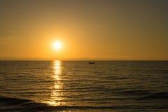 Sunrise with fishing boat stock photos