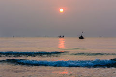 Sunrise with fishing boat Royalty Free Stock Photos