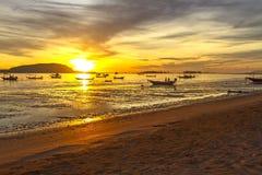 Sunrise and fishing boat Stock Photos