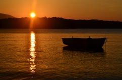 Sunrise with fishing boat Stock Photography