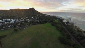 Sunrise flight towards Diamond Head in Oahu, Hawaii, United States stock footage