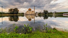 Sunrise at floating mosque stock photography