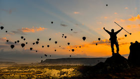 Sunrise and flying balloons. Summit success and peace concept. balloons flying in the sky and sunrise stock photography