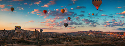 Sunrise and flying hot air balloons over the valley Cappadocia,. Sunrise over the valley in Cappadocia, Turkey. Hot air balloons flying over field Royalty Free Stock Photos