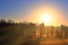 Sunrise in fog Stock Photos